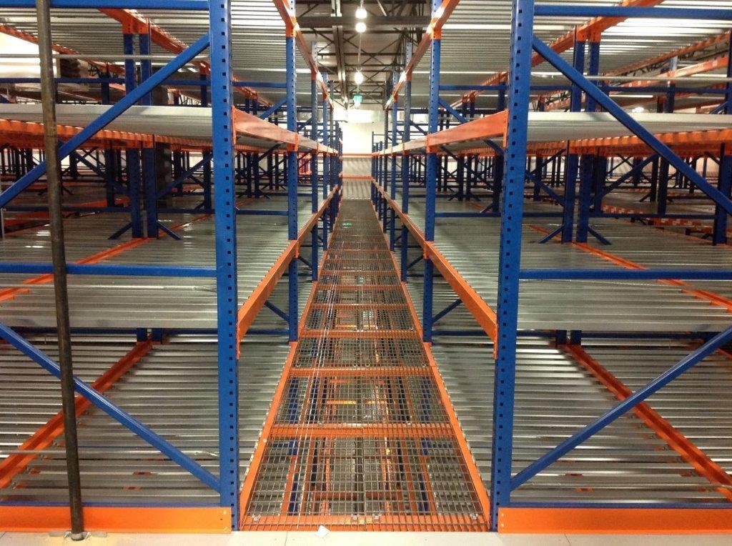 blue and orange custom designed SpaceRak system in distribution warehouse card