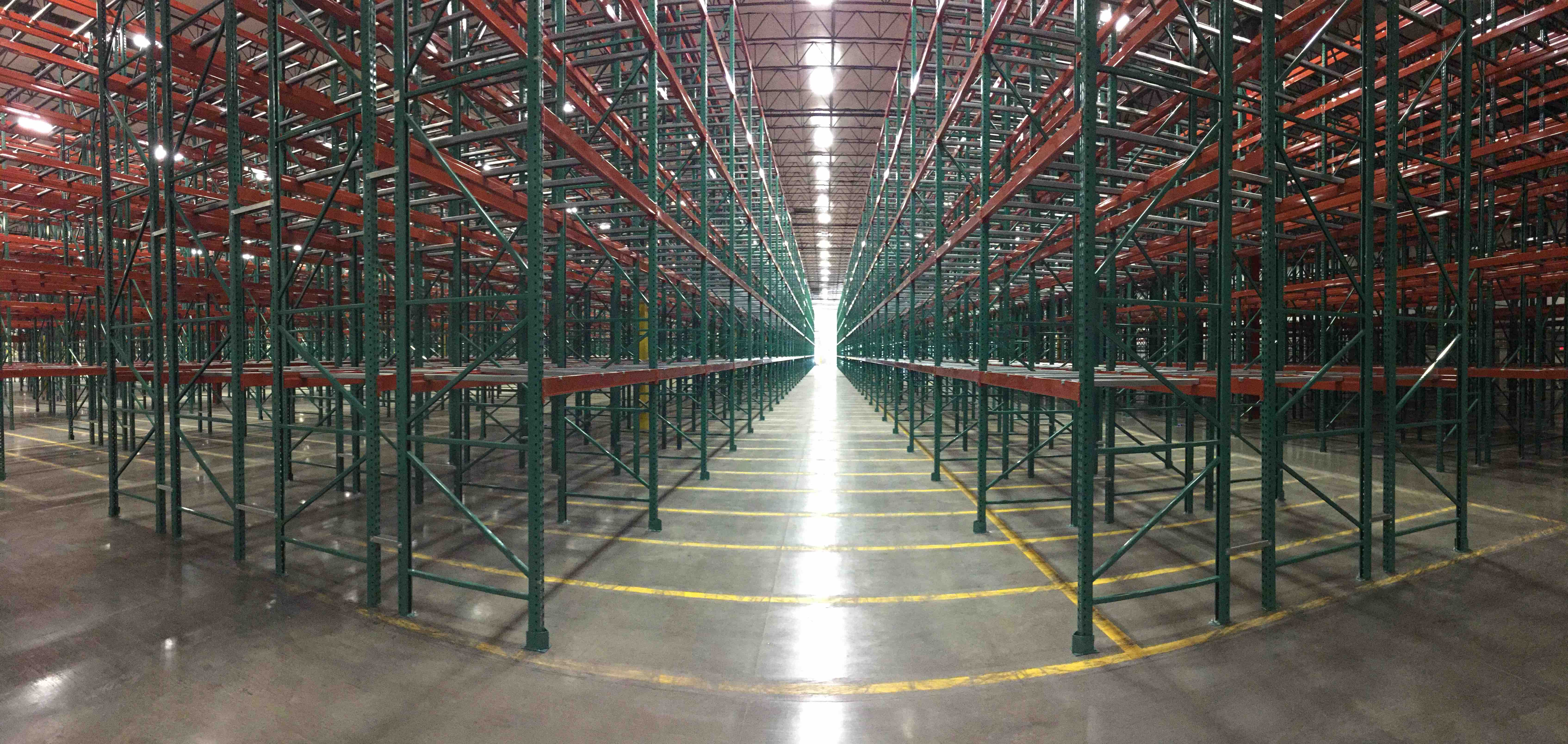 bulk storage facility with OSHA approved red and green steel racking